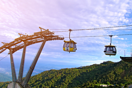 Malaysia - MAY 13 2013: the Cable Car with blue sky background and green forest mountain in Genting Highland in Malaysia