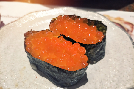paired of a lot of salmon egg sushi wrapped with seaweed Archivio Fotografico