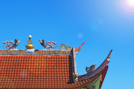 bird sculpture statue on roof top of pubclic chinese temple in Fang, Chiang Mai north of Thailand Stock Photo