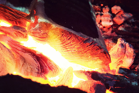 close up of fire burning charcoal for food grilling