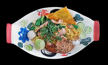 thai spicy dried noodle called Tom Yum Haeng served in common thai style bowl isolated