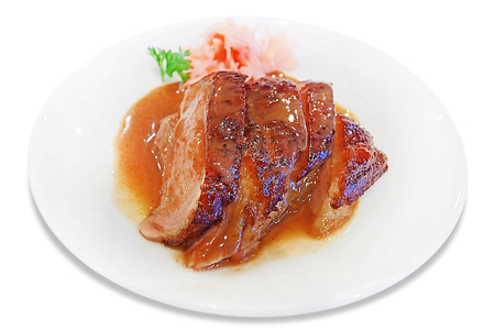 Chinese Cuisine - Grilled Duck Breast cut in piece served on white plate dish with traditional ginger pickle isolated on white background
