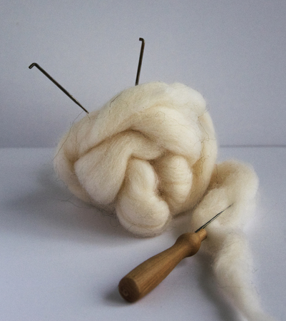Felting wool and tools: needles, handle for needles.Concept hand made Stock fotó