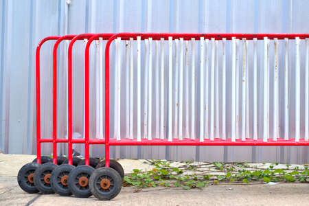 A group of red traffic barrier. using for keep vehicles within their roadway and prevent them from colliding with dangerous.