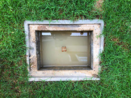 a hole of drainage system or water drain around the house stock photo 105452257