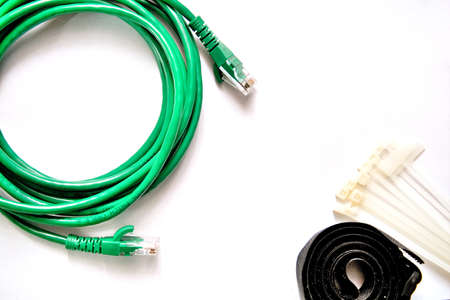 Blue and Green LAN cable with cable ties and cable strap on the white background. Foto de archivo