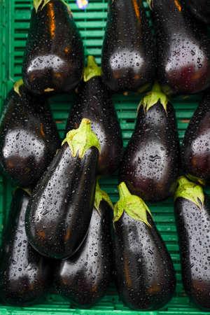 Fresh purple eggplant on the basket in the fruit market. Stock fotó