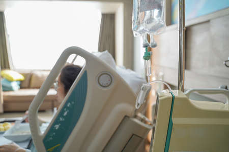 The fluid intravenous drip saline dropping for the admit patient in the room at hospital.