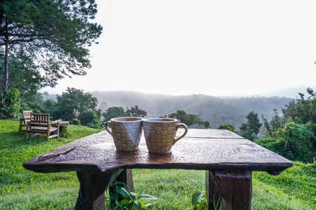 A couple coffee cup with mountain natural view in the morning time at Khao Kho, Thailand. Imagens