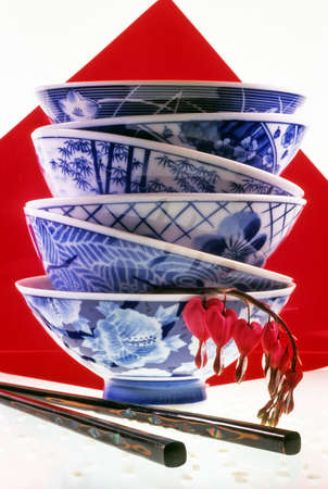 Six stacked blue and white oriental rice bowls  photo