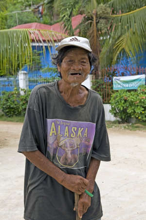 Portrait of an old Filipino man with a wrinkled face.