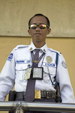 Portrait of a Filipino Security Guard outside a shopping mall in Legazpi City, Philippine Islands. Stock Photo - 16769507