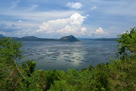 Scenic view of Taal Volcano, smallest volcano in the world, and fish farms situated in the center of Taal Lake, the caldera of a super volcano, in Tagaytay, Philippines  photo