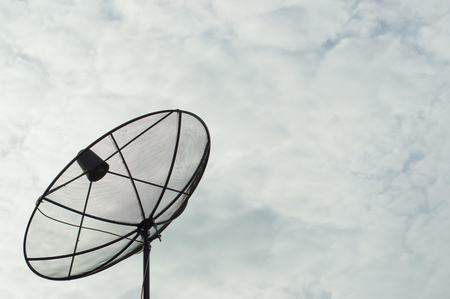 metal mesh: Telecommunication concept. Old satellite antenna