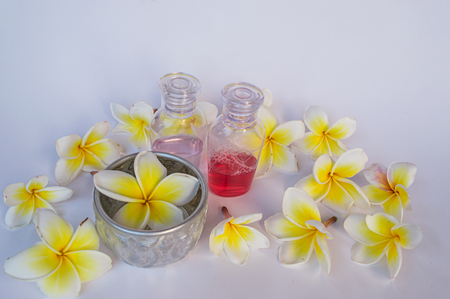 champa flower: Dok champa flowers,Thai Silver Bowl and small bottle of shampoo and of shower gel isolate