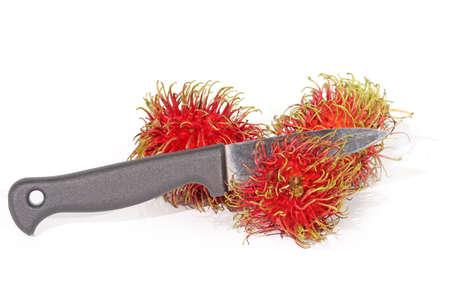 paring knife: A paring knife Rambutan
