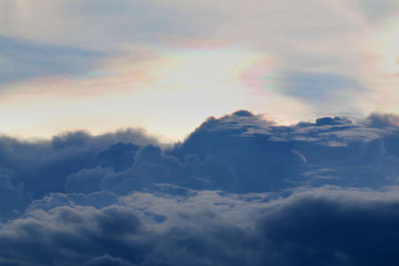 Iridescent pileus cloud  Rainbow clouds Фото со стока