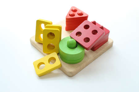 Childrens wooden blocks photographed over white background