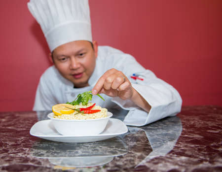 asian chef: Asian Chef with noodles and red background
