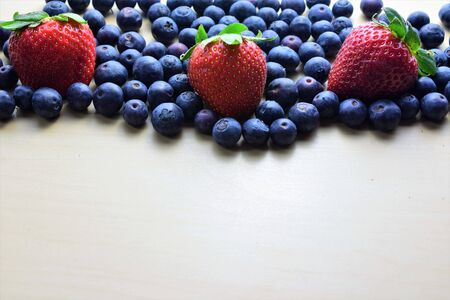 Close up strawberries and blueberries. Space for text.