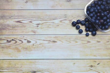 Tray with blueberries, wooden table background Stock Photo
