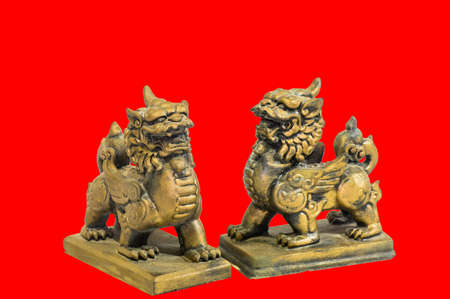 plenitude: Chinese talisman figurine red background Stock Photo
