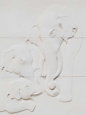 carved stone: Elephants carved stone walls.