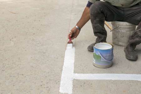striping: Painters Striping Parking Stock Photo