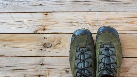 hiking shoes: Green Hiking shoes on wood