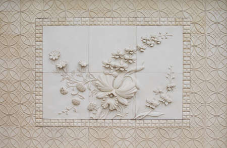 carved stone: Orchid flowers carved stone walls. Stock Photo