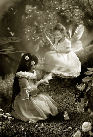 The Fairy-tale night. Two young girls try the small shoes and laugh. Stock Photo