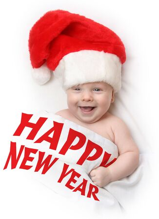 The Child in red hat of Santa on white background.