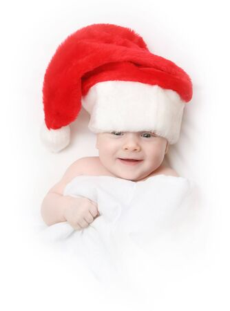 The Child in red hat of Santa on white background. photo