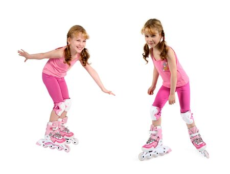 teeths: The Small girl is dressed in pink on white background. She is going to roller-skate. Stock Photo