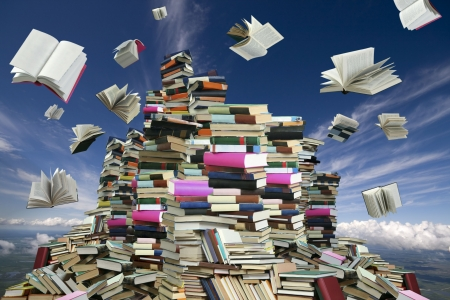 publish: This is books mountain. Many books on background of white clouds and blue sky.