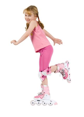 The Small girl is dressed in pink on white background. She is going to roller-skate. Stock Photo