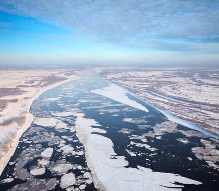 Aerial view of the great river with floating ice floes during the frosty days. Drifting of ice.Driving of ice. Ice floe.  photo