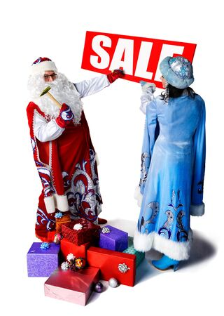 Santa Claus and his helper to placed a ad of holiday. photo