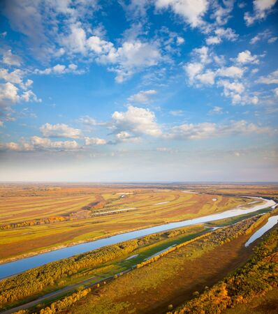 floodplain: Aerial view of the floodplain of river under clouds during the autumn