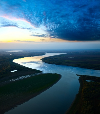 It is aerial view the great river during twilights  On the river is calm now  Beautiful clouds are reflected in quiet water