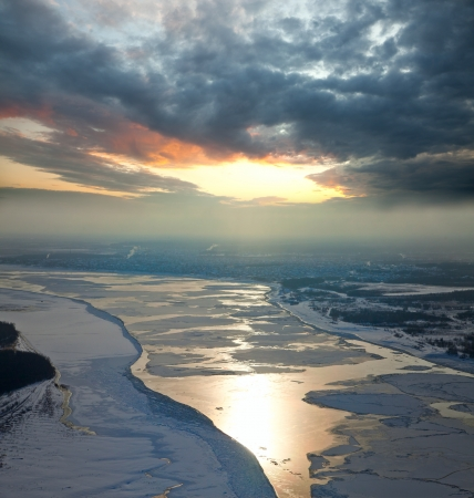 floe: Aerial view of the great river with floating ice floes during sundown. Drifting of ice. Driving of ice. Ice floe.
