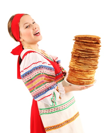 Little girl holds stack of pancakes in her hands on white background.