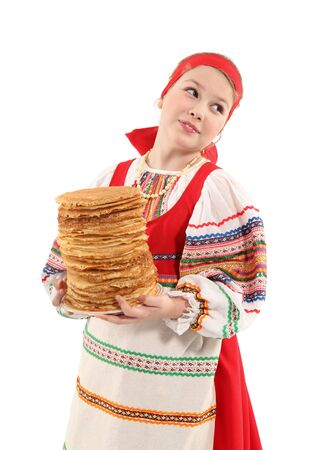Little girl holds stack of pancakes in her hands on white background. photo