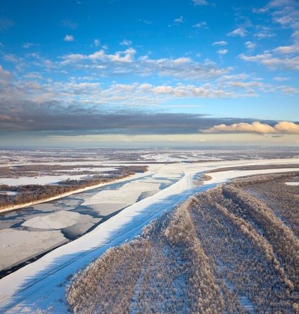 drifting ice: Aerial view of the great river with floating ice floes during the spring day. Drifting of ice. Driving of ice. Ice floe.