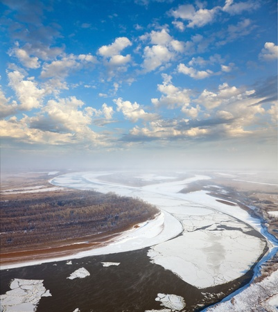 ice floes: Aerial view of the great river with floating ice floes during the spring day. Drifting of ice. Driving of ice. Ice floe.