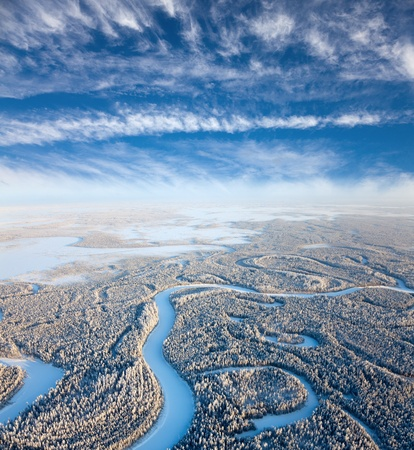 Aerial view of forest river in time of winter day   photo
