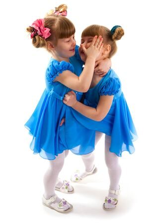 Twin girls fighting each other  photo
