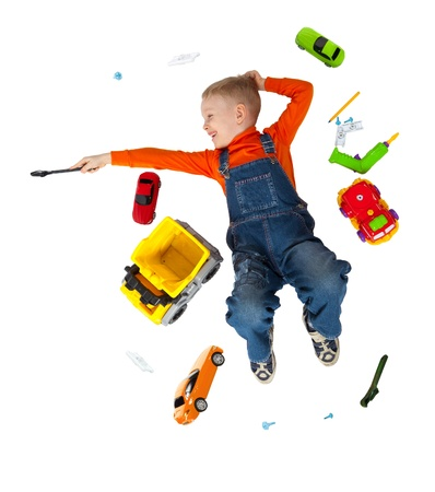 Little cute boy repairing a plastic toy truck  Isolated on white Stock Photo - 18938383