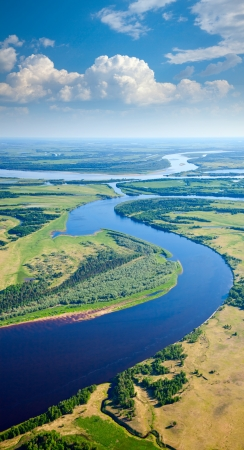 Aerial view of the river executing the loop during the cloudy day of autumn  Stock Photo