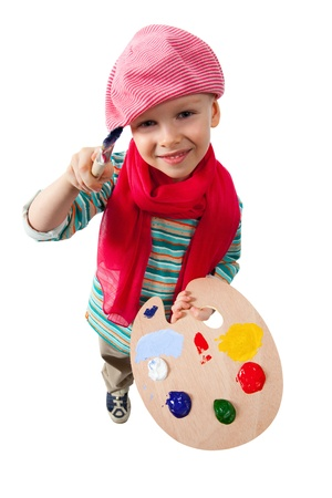 Young artist holds in his hands the palette with paints.